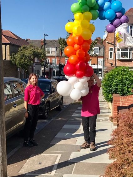 Our gorgeous delivery driver with a rainbow column!